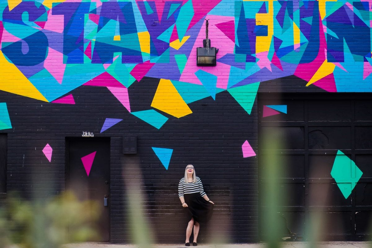 Christine Tremoulet in front of the Stay Fun wall in Austin, Texas